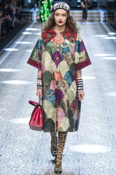 Dolce and Gabbana Multi Embroidered Print coat. The color and design is unique I loved that fact. It also seems to be a very versatile piece can be worn as a jacket, a dress and with several colors and designs.