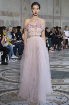 Giambattista Valli offers this very feminine pretty and just versatile dress. The pleats really give this dress its balance.