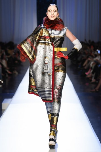 Jean Paul Gaultier Offered this gorgeous 2 piece jumpsuit. The jumpsuit with the mathing coat really caught me. Good look.