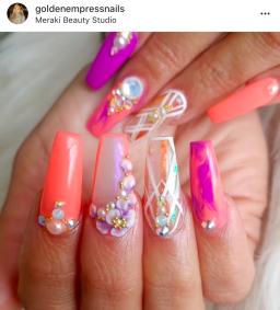 coffin shaped peachy purple nail design