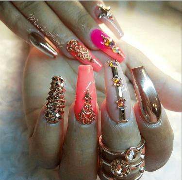 Peachy and gold nail design Swaroski
