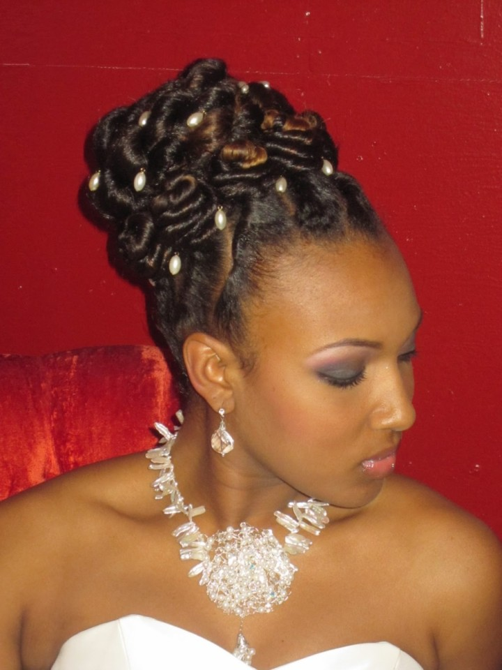 back-curly-black-wedding-updo-hairstyles-with-multi-pearls-hair-pins-945x1260