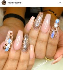 Beige nail design blue rhinestone