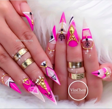 Pink and white Stiletto nails with gold embellishments