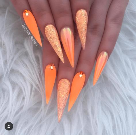 Orange Acrylic and glitter stiletto nails