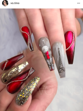 Gray and red eifle tower nail design