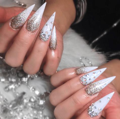 Long stiletto white nails with rhine stones