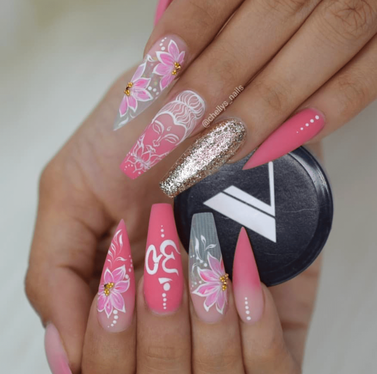 Salmon pink nail design coffin and stiletto shaped nails ...