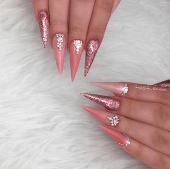 Mauve pink glitter nails stiletto
