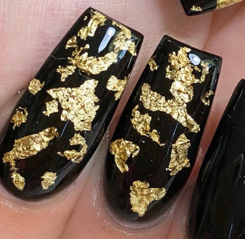 Black nails with gold foil encapsulated